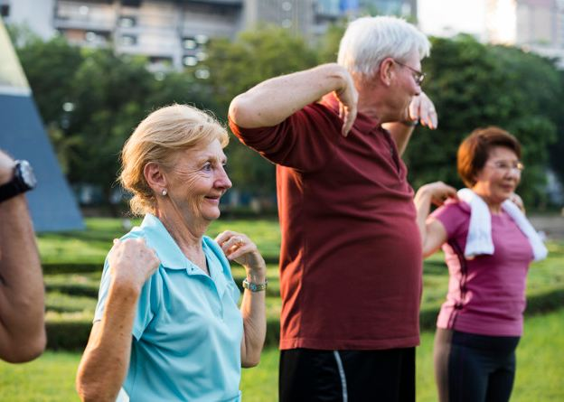 Image of three senior citizens working out for a healthy life.